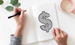 Un dollar dessiné sur un cahier